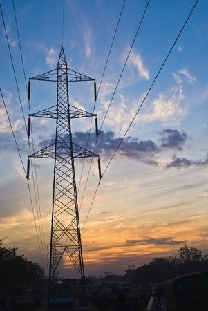 haryana: Clouds over an electricity pylon, Gurgaon, Haryana, India Stock Photo