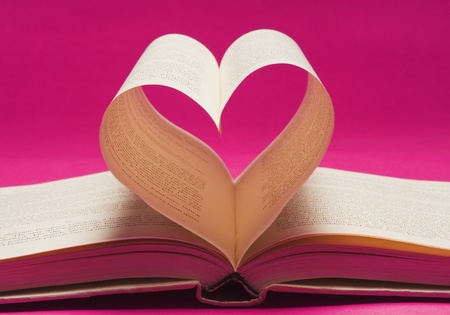 Pages of a book making a heart shape Standard-Bild
