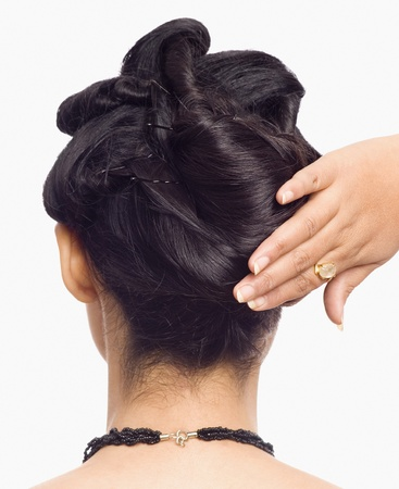 Person's hand styling a young woman's hair Stock Photo - 10123727