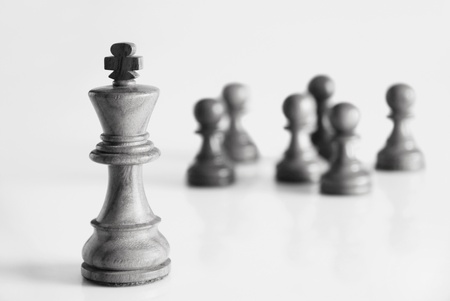King with chess pawns in the background Stock Photo - 10205687