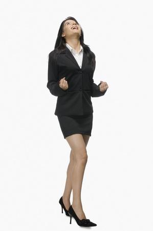 photosindia: Businesswoman clenching her fist with joy