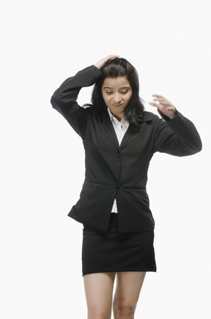 disheartened: Businesswoman with her hand in hair
