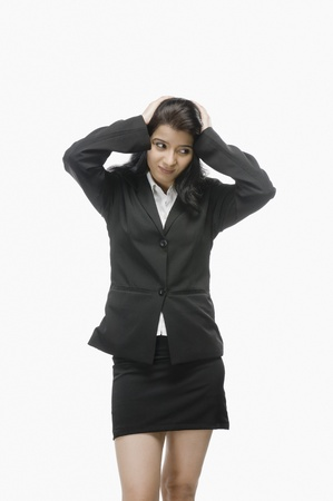 brooding: Businesswoman with her hand in hair