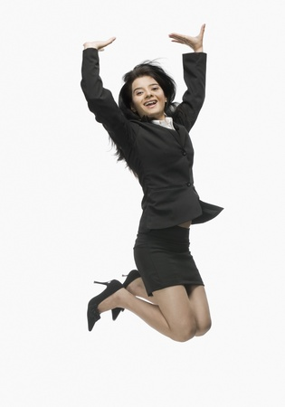 Portrait of a businesswoman jumping with joy Stock Photo - 10126309