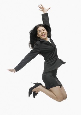 Portrait of a businesswoman jumping with joy