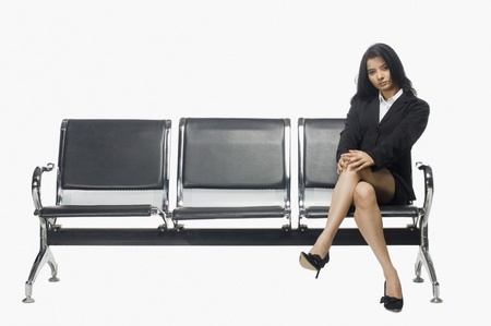 Businesswoman sitting on an armchair Stock Photo
