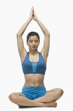 rfbatch15: Young woman practicing yoga against white background LANG_EVOIMAGES