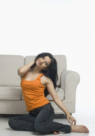 rfbatch15: Young woman stretching near a couch