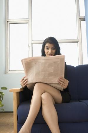 photosindia: Businesswoman reading a financial newspaper