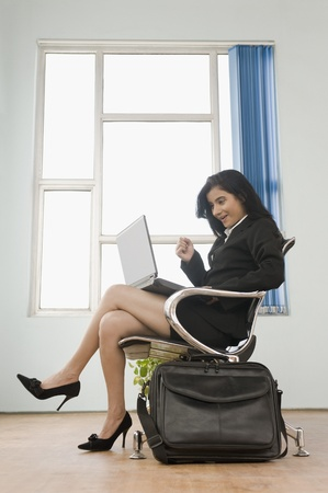 Businesswoman using a laptop Stock Photo - 10126003