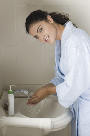 Young woman washing her hands Stock Photo - 10126043