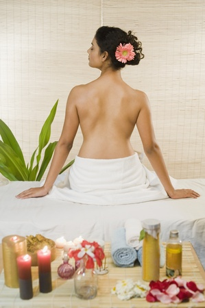 Young woman sitting on a massage table Stock Photo - 10125996