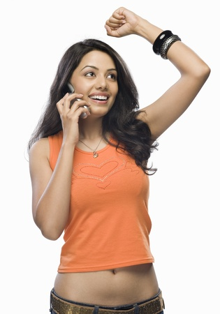 Young woman talking on a mobile phone Stock Photo - 10126125