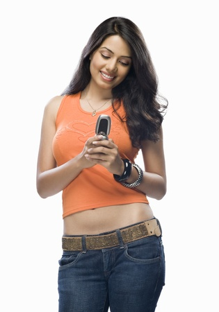 Young woman text messaging Stock Photo - 10123639