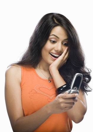 message: Shocked young woman reading text message