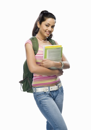 Portrait of a female college student holding files Stock Photo - 10169526
