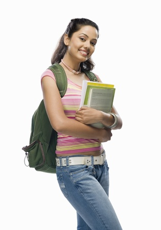 rucksacks: Portrait of a female college student holding files LANG_EVOIMAGES
