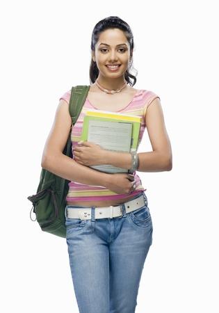 Portrait of a female college student holding files 版權商用圖片