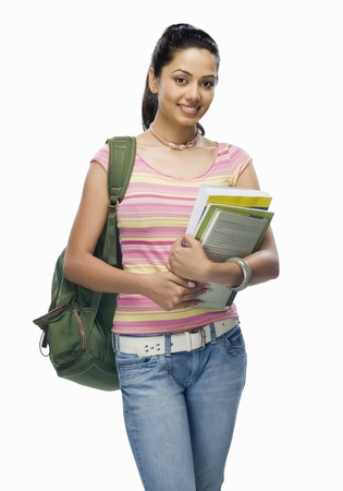 college student: Portrait of a female college student holding files LANG_EVOIMAGES
