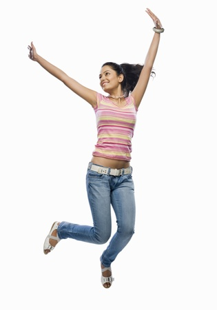 triumphing: Young woman jumping