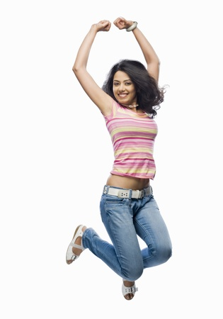 triumphing: Portrait of a young woman jumping LANG_EVOIMAGES