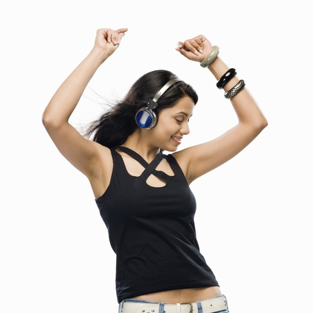 Young woman listening to music and dancing Stock Photo - 10126307