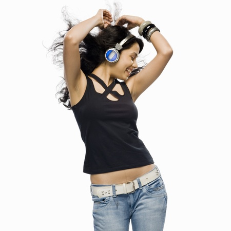 woman dancing: Young woman listening to music and dancing