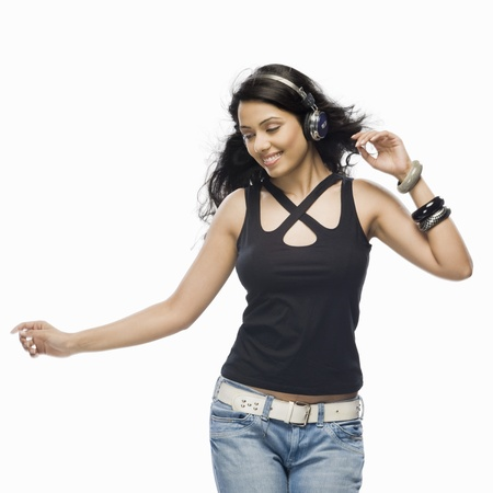 music background: Young woman listening to music and dancing