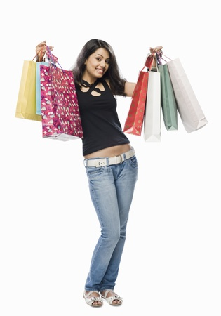 Portrait of a young woman holding shopping bags Stock Photo - 10126249