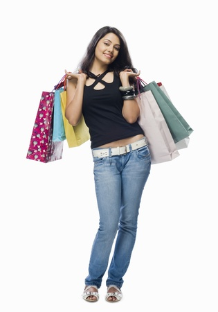 Portrait of a young woman holding shopping bags Stock Photo - 10126260