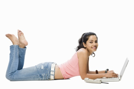 Portrait of a young woman using a laptop Imagens