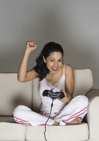 Portrait of a young woman playing video game Stock Photo - 10126058