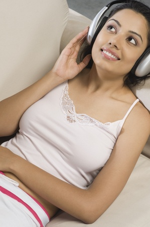 Young woman listening to music Stock Photo - 10125960