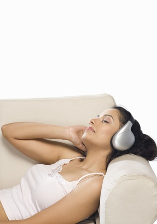 rest in peace: Young woman listening to music