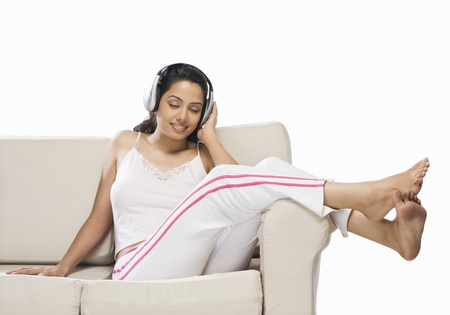 Young woman listening to music Stock Photo - 10126253