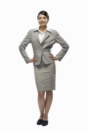 Portrait of a businesswoman standing against a white background Stock Photo - 10123478
