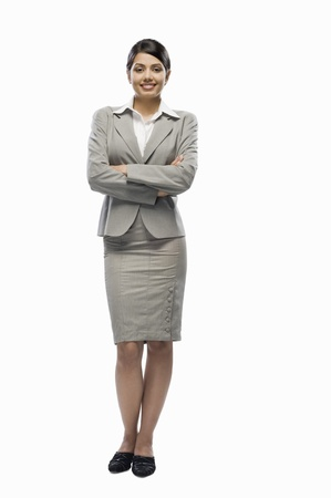 Portrait of a businesswoman standing against a white background Stock Photo - 10123464