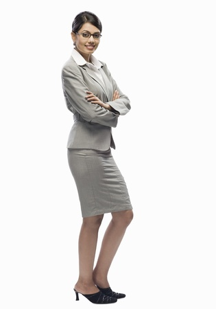 Portrait of a businesswoman standing against a white background Stock Photo - 10123460