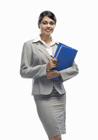 Portrait of a businesswoman holding a file and standing against a white background Stock Photo - 10123531