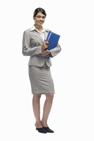 Portrait of a businesswoman holding a file and standing against a white background Stock Photo - 10123470