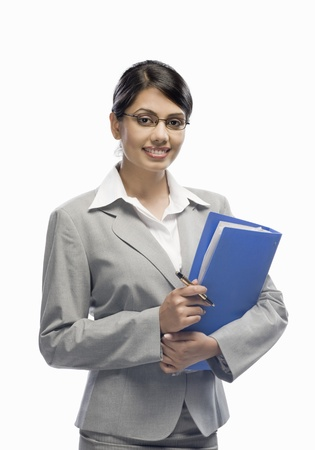 x files: Portrait of a businesswoman holding a file and standing against a white background