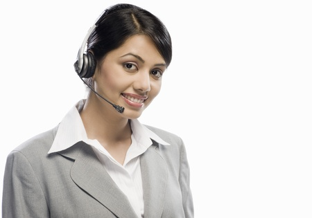 Female customer care executive wearing a headset against a white background Stock Photo - 10123600