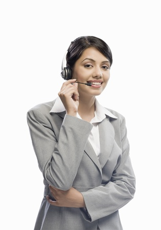 Female customer care executive wearing a headset against a white background Stock Photo - 10123623