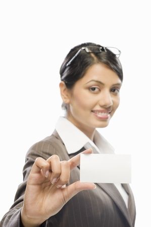 corporate culture: Portrait of a businesswoman showing a business card against a white background
