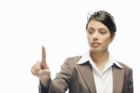 Businesswoman showing her index finger against a white background Stock Photo - 10126325