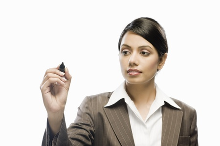 Businesswoman writing on a blank space against a white background Stock Photo - 10126313