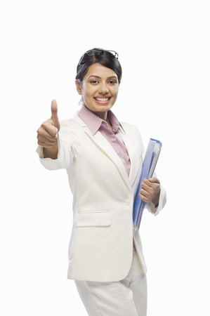 Portrait of a businesswoman showing thumbs up