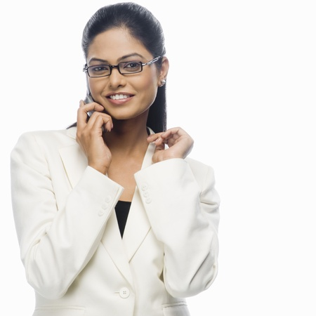 Portrait of a businesswoman talking on a mobile phone LANG_EVOIMAGES
