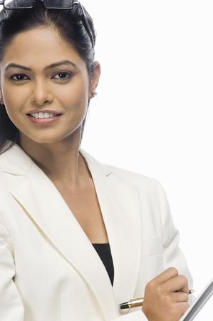 photosindia: Portrait of a businesswoman writing on a file