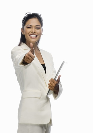 Portrait of a businesswoman showing thumbs up Stock Photo - 10123476
